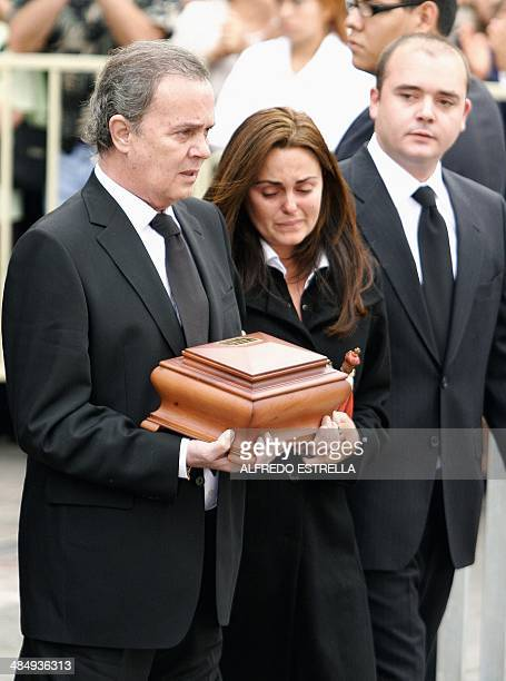 The widower Antonio Morales Barretto aka Junior and Carmen and Antonio sons of the spanish singer Rocio Durcal carry the urn containing her ashes...