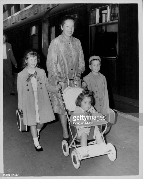 The wife and children of actor Peter Ustinov; Suzanne Cloutier with Pavla, Igor and Andrea Claudia, arriving at Victoria Train Station, London, July...