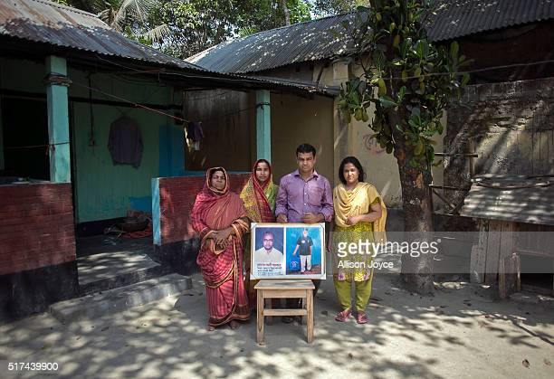 The wife and children of Christian convert Hossain Ali who was murdered by ISIS hold his photograph as they pose for a photo March 23 2016 in...