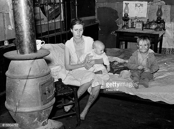 The wife and two children of an unemployed mine worker living in an old company store in an abandoned mining town She is suffering from both...