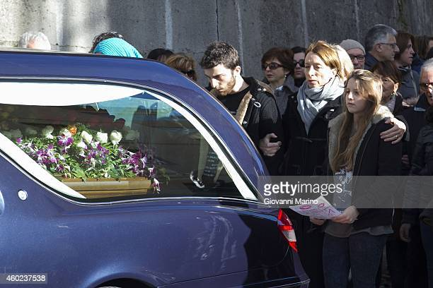The wife Laura Valente and childrens Angelina and Filippo following the coffin of the singer Mango on December 10 2014 in Lagonegro Italy