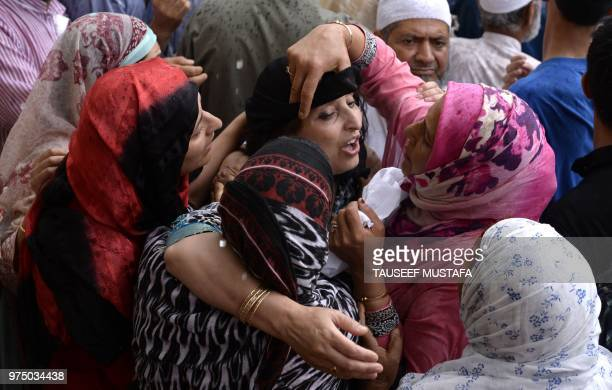 The wife of a slain editorinchief of the Srinagarbased newspaper Rising Kashmir Shujaat Bukhari mourns during the funeral procession at Kreeri some...