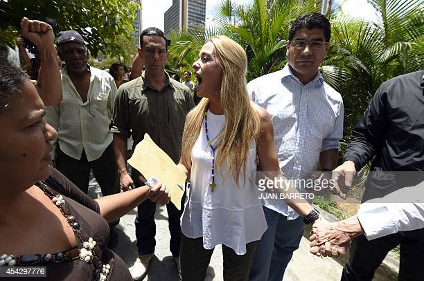 The wife of arrested opposition leader Leopoldo Lopez Lilian Tintori walks in front of the court in Caracas on August 28 2014 AFP PHOTO/JUAN BARRETO