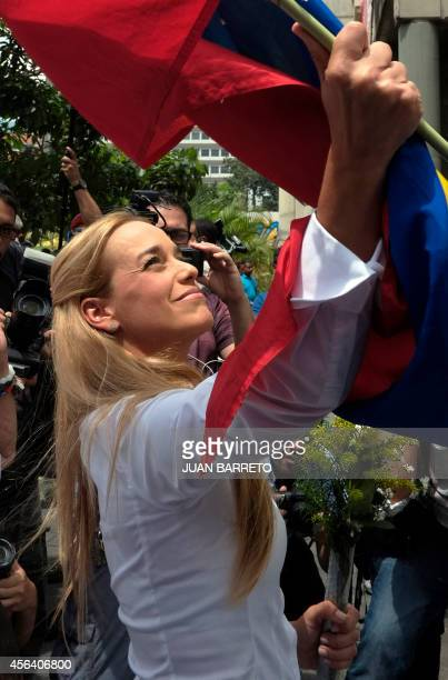 The wife of arrested opposition leader Leopoldo Lopez Lilian Tintori holds a national flag upon arrival at the courthouse for the third hearing of...