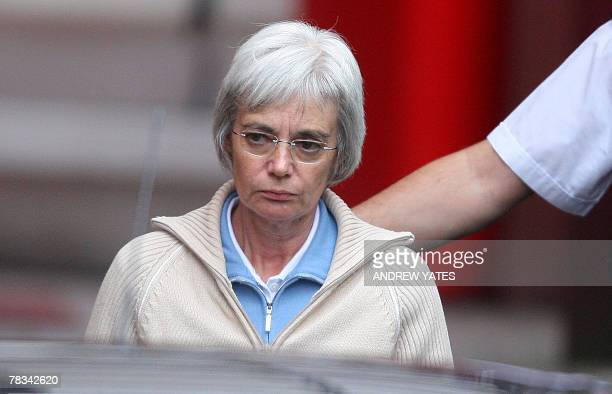 """The wife of """"back-from-the-dead"""" Briton John Darwin, Anne Darwin, leaves 09 December 2007 Manchester Airport police station before being handed over..."""