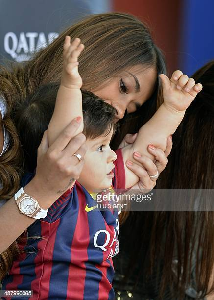 The wife of Barcelona's Argentinian forward Lionel Messi Antonella and their son react prior to the Spanish league football match FC Barcelona vs...