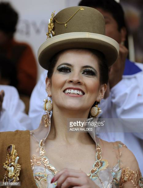 The wife of Bolivian VicePresident Alvaro Garcia Linera Claudia Fernandez dances with the Morenada Central Cocanis brotherhood during the Carnival of...
