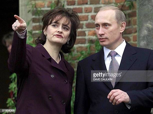 The wife of Britain's Prime Minister Cherie Blair speaks with the President of the Russian Federation Vladimir Putin on the steps of Chequers the...