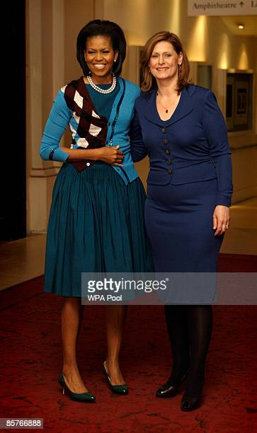 The wife of Britain's Prime Minister Sarah Brown greets U.S. First lady Michelle Obama as the G-20 spouses visit the Royal Opera House in Covent...