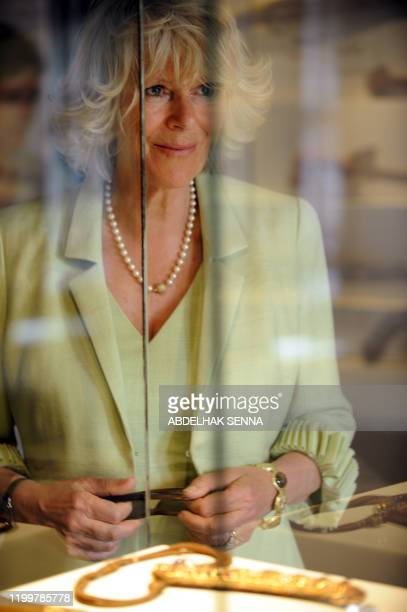 The wife of Britain's Prince Charles Camilla looks out from behind the glass enclosing an exhibit at the museum in the Oudayas Kasbah a fortified...