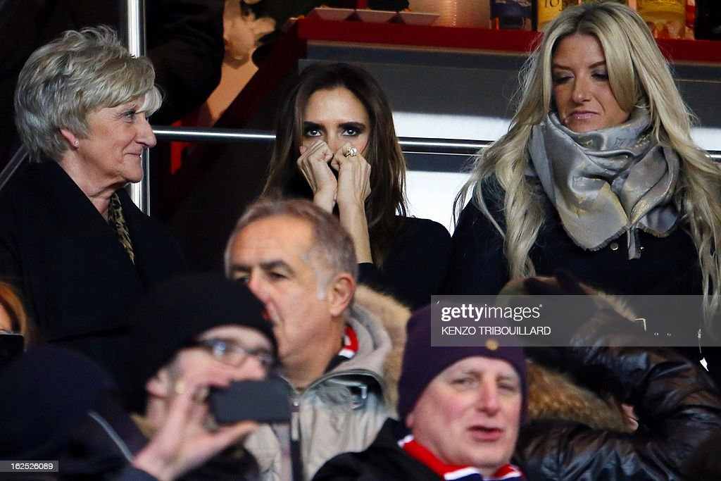 The wife of British football player David Beckham, Victoria Beckham (C) is pictured in the stands with David Beckham's mother Sandra Beckham (L) and sister Joanne Beckhamd uring the French L1 football match Paris Saint-Germain (PSG) vs Olympique de Marseille (OM) on February 24, 2013 at the Parc des Princes stadium in Paris.