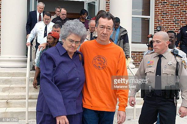 The wife of Edgar Ray Killen Betty Joe Killen is escorted by her son away from the Neshoba County Courthouse January 12 2005 in Philadelphia...