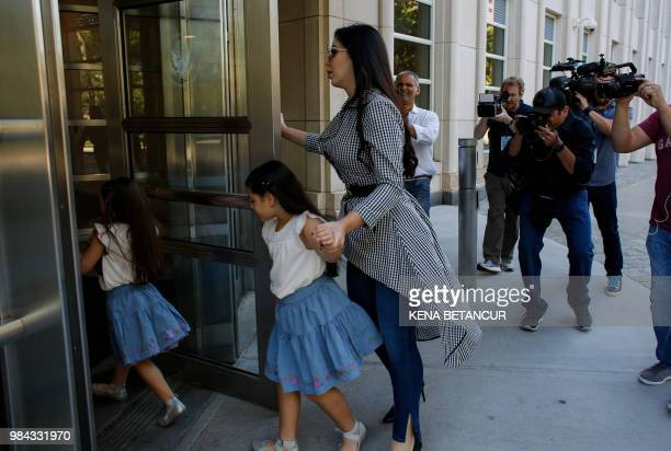 The wife of 'El Chapo', Emma Coronel Aispuro, arrives with her twin daughters at the US Federal Courthouse in Brooklyn before a hearing in the case...