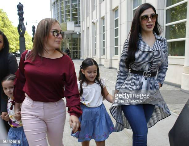The wife of 'El Chapo', Emma Coronel Aispuro, leaves with her twin daughters from the US Federal Courthouse in Brooklyn after a hearing in the case...