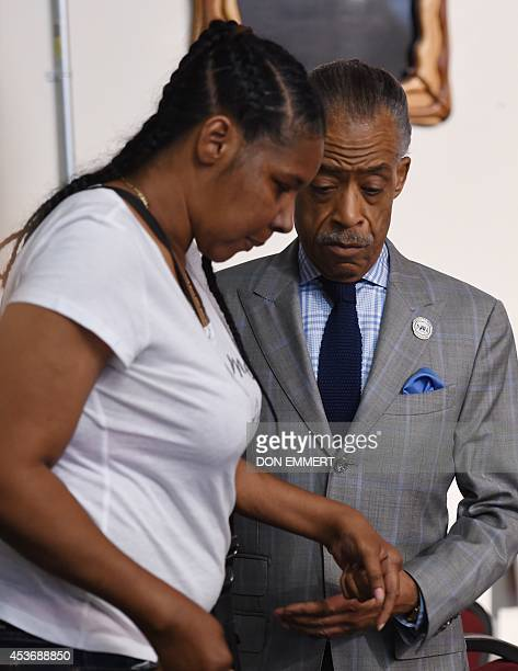 The wife of Eric Garner and the Reverand Al Sharpton at the House of Justice August 16 2014 in New York Sharpton addressed what he called a smear...