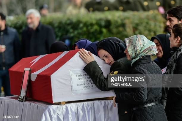 TOPSHOT The wife of Fatih Mehmethan a Turkish soldier killed in crossborder clashes with Kurdish People's Protection Units forces in Afrin reacts...