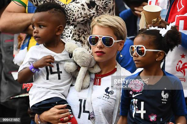 The wife of France's midfielder Blaise Matuidi Isabelle and her children wait for the start of the Russia 2018 World Cup final football match between...
