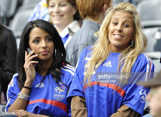 The wife of French defender Eric Abidal and the wife of French midfielder Franck Ribery are seen in the stands before the Euro 2008 Championships...