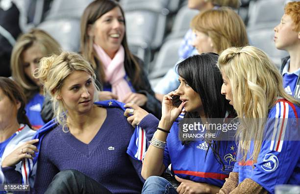 The wife of French defender Eric Abidal and the wife of French midfielder Franck Ribery speak with Samir Nasri girlfriend Tatiana Golovin before the...