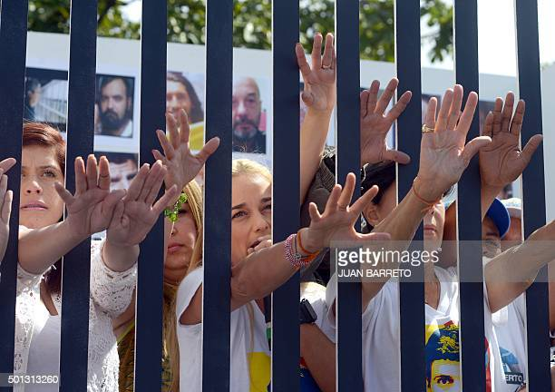 The wife of jailed Venezuelan opposition leader Leopoldo Lopez Lilian Tintori and relatives of political prisoners pose inside a mock prison cell...