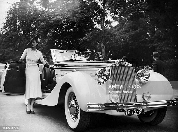 The Wife Of Jeweller Louis Arpels Being Awarded The Honor Prize For Her Delahaye Car'S Elegance