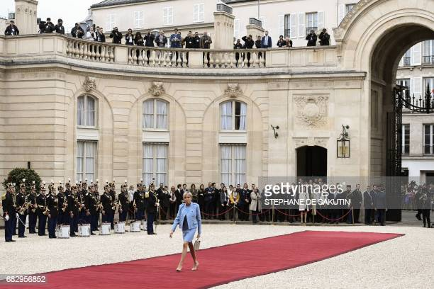 The wife of Newly elected French President Emmanuel Macron Brigitte Trogneux arrives at the Elysee presidential Palace to attend Emmanuel Macron's...