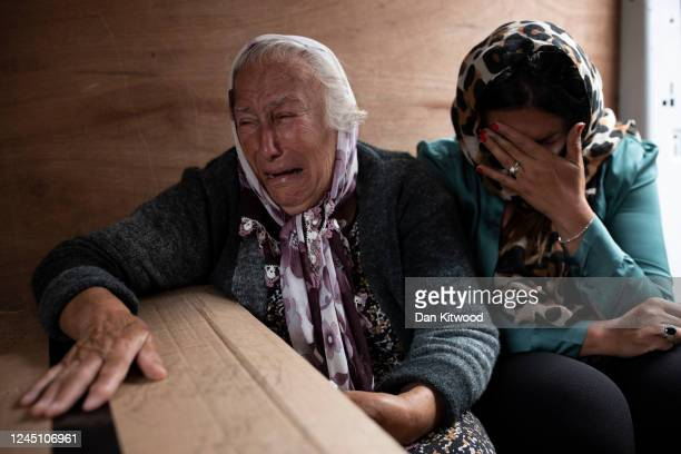 The wife of Orhan Misiri Serife and daugher Hanife Da Costa react beside his coffin as families gather for the sendoff of loved ones who are to be re...