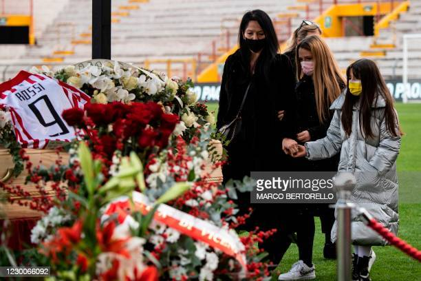 The wife of Paolo Rossi, Federica Cappelletti and their two daughters say a final farewell to the former Italian football player, as his coffin is on...