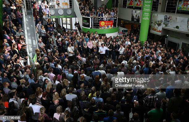 The wife of Prime Minister and leader of the conservatives David Cameron Samantha Cameron looks on above as her husband addresses a crowd of workers...