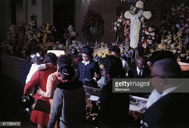 The wife of slain civil rights leader Dr Martin Luther King Coretta Scott King wearing a black suit and hat can be seen grieving between the line of...