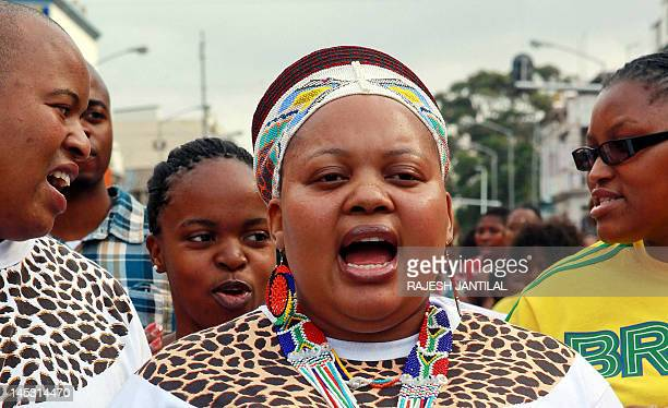 The wife of South African President Jacob Zuma Ma Ntuli joins hundreds of people during a demonstration called by the South African Traditional Music...