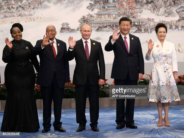The wife of South Africa's President Thobeka Madiba Zuma and South African President Jacob Zuma Russian President Vladimir Putin Chinese President Xi...
