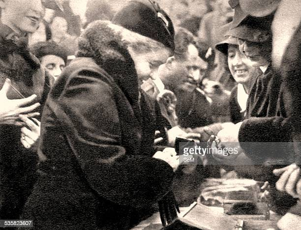 The wife of the Duce Rachele Mussolini gave her wedding ring during the ceremony at the monument of the Altar of the Homeland Gold to the homeland...