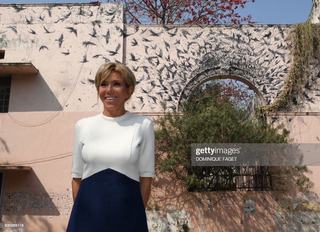 The wife of the French President Emmanuel Macron, Brigitte Macron, poses for a photograph during a visit to Lodhi Colony, known for its street art, in the Indian capital New Delhi on March 11, 2018. Brigitte Macron is visiting India with her husband on an official three-day state visit where they will travel to New Delhi, Agra and Varanasi. /
