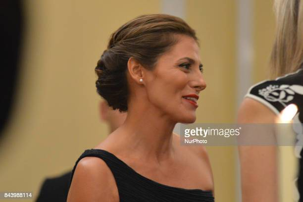 The wife of the Greek Prime Minister Alexis Tsipras Betty Baziana during a state dinner at the Presidential mansion in Athens on September 7 2017