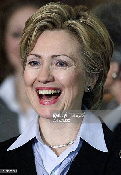 The wife of US President Bill Clinton Hillary Rodham Clinton laughs as she prepares to speak to women leaders in Dublin 12 December 2000 Bill Clinton...