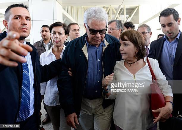 The wife of Venezuelan opposition leader Antonio Ledezma Mitzy Capriles greets former Spanish Prime Minister Felipe Gonzalez upon arrival at...