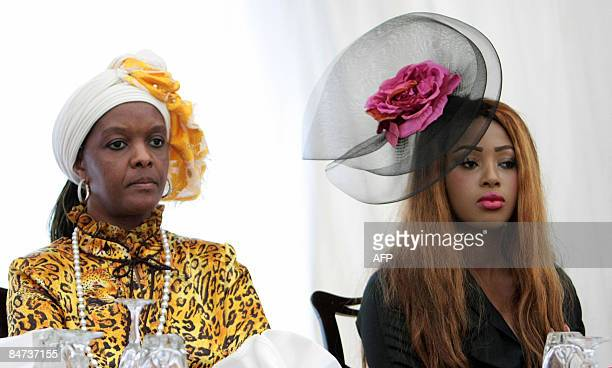 The wife of Zimbabwean President Robert Mugabe Grace and one of the wives of King Mswati III of Swaziland attend the swearingin ceremony of new Prime...