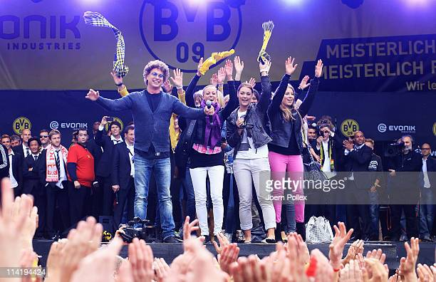 The wifes of the player from Dortmund and entertainer Atze Schroeder celebrate with the fans winning the German Championship at the Westfalenhalle on...