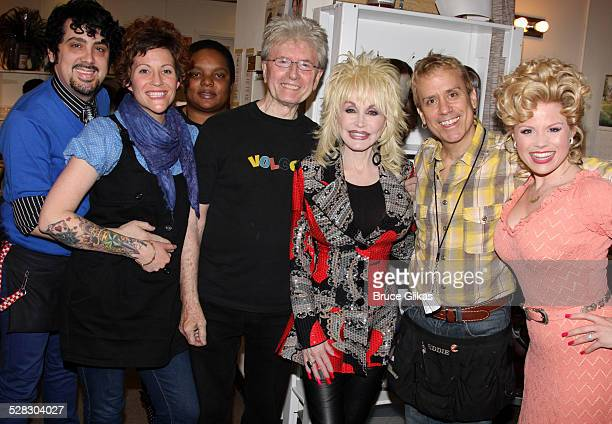 The Wig and Hair team with Dolly Parton and Megan Hilty pose backstage at the hit new musical 9 to 5 on Broadway at The Marquis Theatre on April 13...