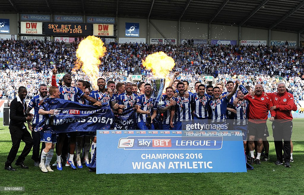 The Wigan Athletic players celebrate winning the 2015/16 Sky Bet League One Championship at the end of the Sky Bet League One match between Wigan Athletic and Barnsley at DW Stadium on May 8, 2016 in Wigan, England.