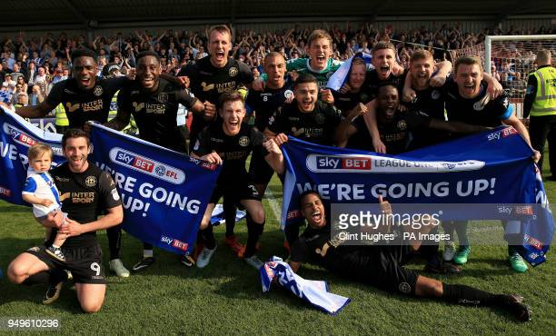 The Wigan Athletic team celebrate their promotion to the EFL Championship during the Sky Bet League One match at Highbury Stadium Fleetwood