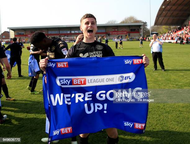 The Wigan Athletic's Ryan Colclough celebrates his sides promotion to the EFL Championship during the Sky Bet League One match at Highbury Stadium...