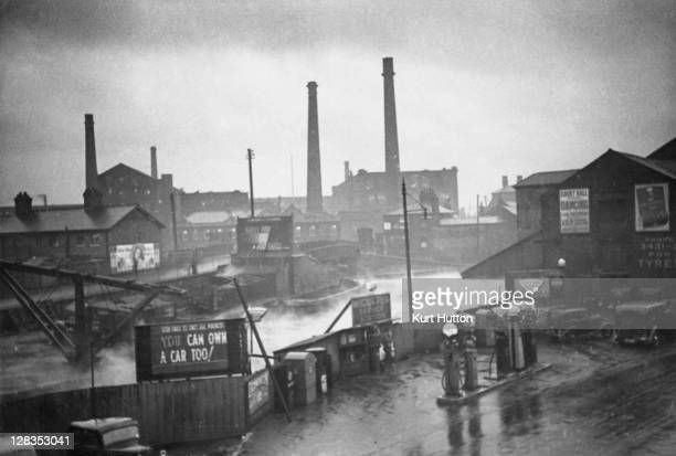The Wigan Pier service station next to the canal in Wigan Greater Manchester UK 1939 Original Publication Picture Post 228 Wigan pub 11th November...