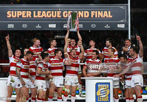 The Wigan team celebrate with the trophy following their 3016 victory during the Super League Grand Final between Warrington Wolves and Wigan...