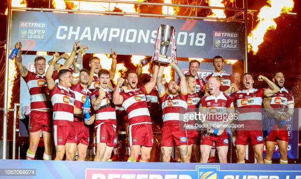 The Wigan Warriors team lift the trophy during the Betfred Super League Grand Final match between Wigan Warriors and Warrington Wolves at Old...