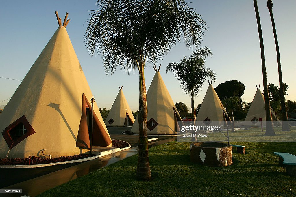 The Wigwam Motel, built in 1949 on old Route 66, consists of teepee-shaped individual rooms on June 15, 2007 in Rialto, California. Route 66 opened in 1926 stretching from Chicago to Los Angeles and became a western migration route for people looking for work during the great depression of the 1930's or to escape the Dust Bowl disaster. Later it offered vacation getaways and driving adventures until 1985 when it was decommissioned as a federal highway. Due to neglect and commercial development Route 66, the first highway to connect the Midwest with the West Coast, has recently been added to the biennially compiled list of the world's most endangered landmarks by the World Monuments Fund and the National Trust for Historic Preservation's yearly list of the 11 most endangered historic places in America.