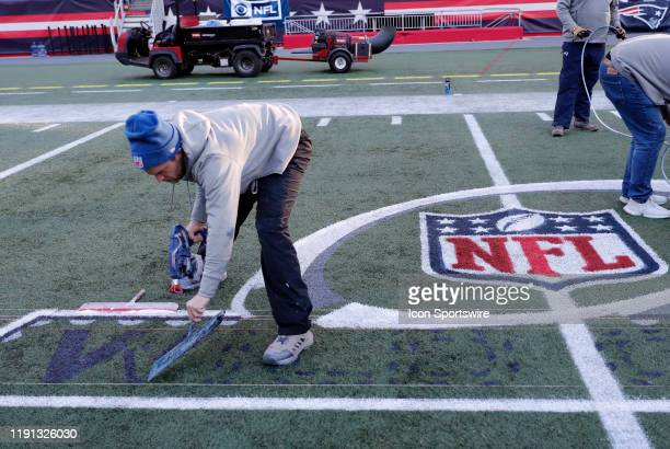 The Wild Card logo is painted on the field during press conferences in advance of the AFC Wild Card Game between the New England Patriots and the...