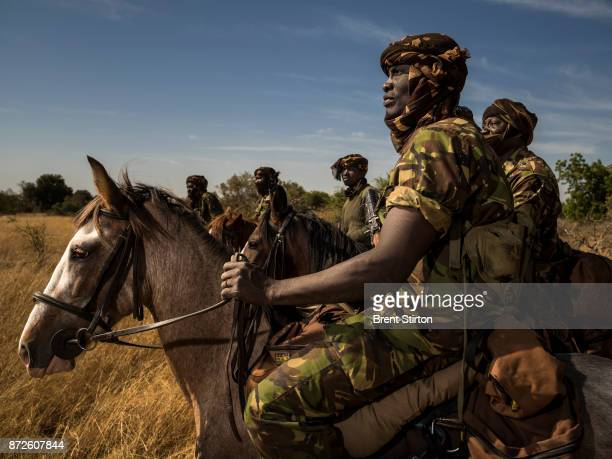 The 'Wild Dog' Ranger horse patrol group as it prepares to leave for a week of anti poaching patrol at Zakouma National Park Chad The horse patrols...