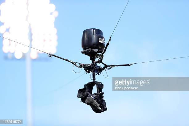 The Wildcat overhead camera by SkyCam, LLC watches the action from above during a college football game between the Oklahoma Sooners and the Texas...